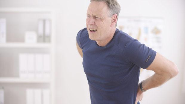 Боль в спине после поднятия тяжести